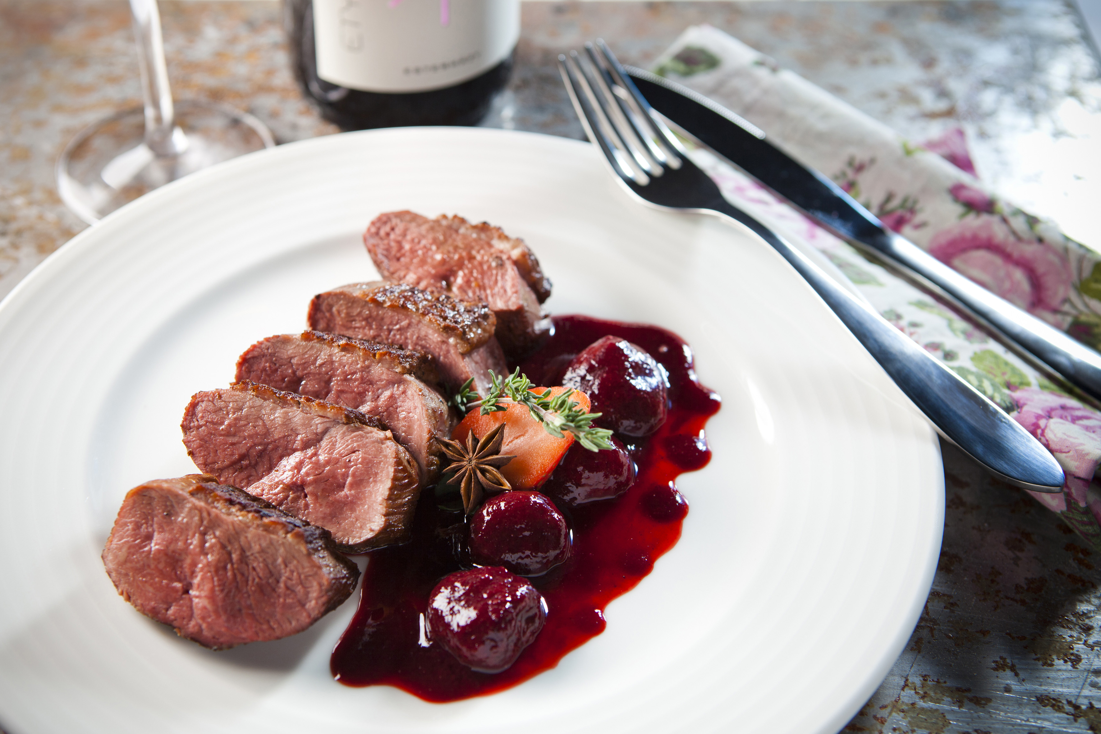 Pink duck breast with star anise and strawberry sauce for Spiced cranberry sauce with orange and star anise